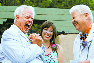 From left, Randy Bennett was ecstatic when he finally got his ring from his partner, Craig Strong, after 30 years.  Amy Miller helped officiate the wedding/ceremony. Even though marriage is not legal in New Mexico they still wanted to acknowledge their life of love together in a ceremony and party. Jane Phillips/The New Mexican