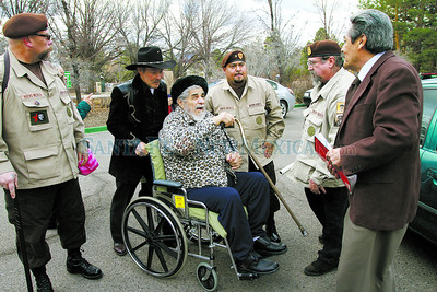 Reies Lopez Tijerina,85, center, is escorted by the Brown Berets, from left, Juanito Burns, Vidal Quintana, pushing his chair, Manuel Avalos, Roy Dodson and Andres Valdez, Executive Director of Vecinos United on Thursday, February 2, 2012 at the New Mexico Statehouse.  Tijerina spoke in the Rotunda. Photos by Jane Phillips/The New Mexican