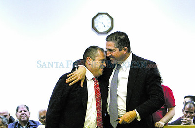 Alfred Lovato gets a hug from his attorney, Sam Bregman, of Bregman & Loman, P.C. after the jury found him not guilty after leaving the scene of the accident in Judge Michael Vigil's courtroom in Distict court on Tuesday, February 21, 2012  Photos by Jane Phillips/The New Mexican