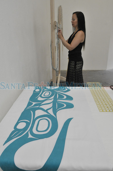 Lisa Hageman Yahgulanaas, of the Yahgulanaas clan of the Raven moiety of Haida Gwaii weaves a RavenÕs Tail at her workstation in the Santa Fe Arts Institute on Thursday, August 18, 2011. For the first time in 90 years, First Nation artists (from Canada) will participate in Santa Fe's Indian Market.  Lisa is the recipient of the SWAIA Residency Fellowship. In collaboration with the Santa Fe Art Institute, SWAIA has established the SWAIA Residency Fellowships-a one-month residency for Native artists during August 2011.<br /> Clyde Mueller/The New Mexican