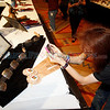 Harrison Ruttenberg, from Santa Fe, scans one of the bar codes on at belt by Pat Pruitt, winner of the Innovation Award at the 2011 Best of Show ceremony at the Santa Fe Indian Market on Aug. 19, 2011. <br /> Photo by Luis Sánchez Saturno/The New Mexican