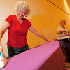Astrid DeAngelis, left, from Santa Fe, and Moksha Smith, back, volunteer to help iron the purple backdrops on Oct. 17, 2009, for the stage that will be used during the Santa Fe Festival of Faiths starting Sunday at the Santa Fe Community Convention Center. The Parliament of the World Religions with meet from the 18th through the 25th.        (Luis Sanchez Saturno/The New Mexican)