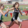 Pojoaque's Kimberly Babicke, left, and Robertson's Kristen Montaño, right, run side by side duirng the 1600 meter relay at the 2010 State Track and Field Championships at Great Friends of UNM Track Complex on May 8, 2010.               Luis Sanchez Saturno/ The New Mexican.