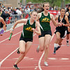 Los Alamos' Sylvia Holland take the baton for her team during the 2x400 meter relay during the 2010 State Track and Field Championships at Great Friends of UNM Track Complex on May 8, 2010.               Luis Sanchez Saturno/ The New Mexican.