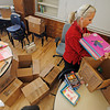 Jane Gee, from Santa Fe, a educational assistant at Carlos Gilbert Elementary School, works on unpacking her class room on Jan. 4, 2010. The staff has begun moving back in to the school which has been closed for more than a year for major renovation of the downtown elementary school.           Luis Sanchez Saturno/ The New Mexican