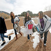 Alli Brimacombe, 14, left, Allison Stertzer, 14, inside left, Leandra Lovejoy, 15, inside right, and teacher Renee Ross, all from Santa, take a load of shoes and dresses to a storage closet at Santa Fe Prep on Jan. 7, 2010. Students at Santa Fe Prep are starting a Prom Closet that would give or lend prom dresses to girls in need as part of a community service requirement they must fulfill for school credit.          Luis Sanchez Saturno/ The New Mexican