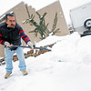 Tomas Aguirre, from Santa Fe, shovels snow out of his side walk on Dunlop St. on Jan. 28, 2010.           Luis Sanchez Saturno/ The New Mexican.