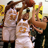 Santa Fe Indian School's Miranda Medina, 23, and Lakesha Padilla struggle with the ball against the West Las Vegas Lady Dons during the second quarter of their game at Francis L Abeyta Memorial Gymnasium, on Friday, Feb. 5, 2010.<br /> Photos by Jane Phillips/The New Mexican
