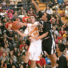 Española Valley High's Antonio Romero tries drives to the basket while Capital High's Paul Toya defends, during the first quarter of their game at Edward Medina Gymnasium in Española on Saturday, February 6, 2010.<br /> Photos by Jane Phillips/The New Mexican