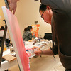 Front, Arnold Castiano, Jr., 29, and Marisa Rheem, 20, work on their paintings at the Museum of Contemporary Native Arts main gallery on Saturday, Feb. 6, 2010. Alumni, students, faculty and staff of the Institute of American Indian Arts (IAIA) created original pieces of art on site from noon to 7 p.m. The work that was created, will  be available on Sunday, Feb. 7, noon to 4 p.m. in a silent auction. The proceeds from the art sales will be divided between the artists and a fund to purchase student work from the 2010 IAIA BFA Graduates Exhibition held at the museum from March 5- May 13th, 2010.<br /> Photos by Jane Phillips/The New Mexican