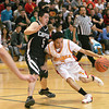 Española Valley's Aaron Aragon dribbles the ball around Capital High's Matt Romero, during the first quarter of their game  at Edward Medina Gymnasium in Española on Saturday, February 6, 2010.<br /> Photos by Jane Phillips/The New Mexican