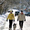 Melinda and Gary Hall take a walk with their Australian Shepard Roxie Tuesday morning Feb. 23, 2010.<br /> Clyde Mueller/The New Mexican