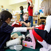 (l-R) Pre-K students Carmen Pacheco, Liliana Romero, and Julia Maurice show each other their new shoes at Kaune Elementary School in Santa Fe, N.M., on Feb. 25, 2010. Los Alamos National Laboratory (LANL) Laces program delivers brand new sports shoes to children participating in the United Way of Santa Fe County's Santa Fe Children's Project. 34 children received new shoes on Thursday. <br /> Natalie Guillen/The New Mexican