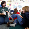 Pre-K teacher, Doris Salazar, helps Grace Maurice put on her new shoes at Kaune Elementary School in Santa Fe, N.M., on Feb. 25, 2010. Los Alamos National Laboratory (LANL) Laces program delivers brand new sports shoes to children participating in the United Way of Santa Fe County's Santa Fe Children's Project. 34 children received new shoes on Thursday. <br /> Natalie Guillen/The New Mexican