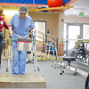 Marcia Bowman, a Physical Therapist at St. Vincent's, work with Randy Murray, from Santa Fe, on his physical rehab on Feb. 24, 2010. The mayor's blueprint calls for 4,000 jobs in 4 years in areas such s health and technology, education, green energy, public safety, media and film, arts and culture and affordable housing.           Luis Sanchez Saturno/ The New Mexican.