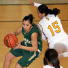 Linda Esquibel, of West Las Vegas, dribbles the ball around Jessica Tsosie, of Santa Fe Indian School, as the Lady Dons beat the Braves to win the girls basketball district 2AAA championship, in Santa Fe, N.M., on Feb. 27, 2010.<br /> Natalie Guillén/The New Mexican