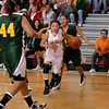 Santa Fe Indian School Braves, Jenine Coriz, #4 dribbles between  Newcomb High School Lady Skyhawks, Bridget Lee, #44 and Gayla Sam, #42 during the second quarter of their game at the Santa Fe Indian School on Friday, March 5, 2010. The Braves were up 20 points at the beginning of the fourth quarter.<br /> Photo by Jane Philips/The New Mexican
