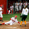 Bernalillo HIgh School Kate Darnell, #6, slides into homeplate while Los Alamos, Monika Teter, #7, tries to tag her out during their  game  on Saturday, April 24, 2010 .Los Alamos will be going to district after their win 15-12.<br /> Photos by Jane Phillips/The New Mexican