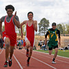 Esteban Vigil (left), of Las Vegas Robertson, wins the 100 meter dash at the district finals track event, held at Santa Fe Indian School in Santa Fe, N.M., on May 1, 2010.<br /> Natalie Guillén/The New Mexican