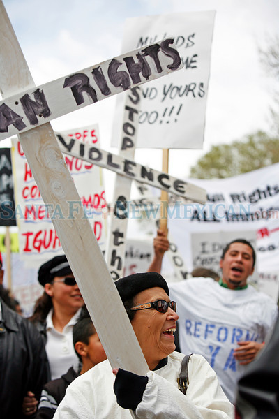 People protesting Arizona's new immigration law gathered outside the DeVargas Center to march to the Plaza in Santa Fe, N.M., for a rally on May 1, 2010.<br /> (she refused to give her name)<br /> Natalie Guillén/The New Mexican