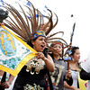 (l-r) Beatriz Vigil, an part of an Aztec dance group, joins in protesting Arizona's new immigration law in Santa Fe, N.M., gathering outside the DeVargas Center to march to the Plaza for a rally on May 1, 2010.<br /> Natalie Guillén/The New Mexican