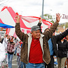 LEDE<br /> (center) Francisco Arzate joins almost 1,000 people in protesting Arizona's new immigration law, gathering outside the DeVargas Center in Santa Fe, N.M., to march to the Plaza for a rally on May 1, 2010.<br /> Natalie Guillén/The New Mexican