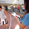 Stephanie Rivera, right, recruiting officer, takes Jocyln Gonzales' time, cq, from Santa Fe, as she finishes her mile and a half run during the Santa Fe Police Department's physical fitness test for recruits at the Genoveva Chavez Community Center on Oct. 24, 2009. Gonzales was retaking that part of the physical test because she missed it by 8 seconds the first time around.        (Luis Sanchez Saturno/The New Mexican)