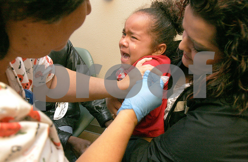 Valerie Paulk hold her daughter, Ayana,3, as Mary Jane Ferran, LPN administers a flu shot at the free clinic on Saturday, October 24, 2009 at  Camino Entrada Pediatrics.  2200  flu shots were injected to children at  two separate clinics, the other was  Arroyo Chamiso Pediatrics.<br /> Photos by Jane Phillips/The New Mexican