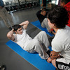 Jocyln Gonzales, cq, from Santa Fe, holds her fist under Ramon Archuleta's chest to help him do push-ups during the Santa Fe Police Department's physical fitness test for recruits at the Genoveva Chavez Community Center on Oct. 24, 2009.        (Luis Sanchez Saturno/The New Mexican)