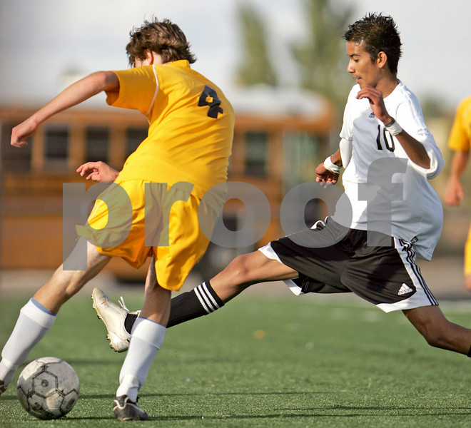 Capital's Victor DeAvila, number 10, challenges the ball from Los Alamos' Chase Havemann, number 4, during the first half of their game at Capital High School on Oct. 24, 2009.        (Luis Sanchez Saturno/The New Mexican)
