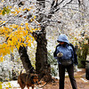 Ellen Burke enjoys a walk with her dog, Luna, after some snowfall in Santa Fe, N.M. on Oct. 28, 2009.<br /> Natalie GuillŽn/The New Mexican
