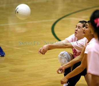 during the first game of their volleyball match at Pojoaque High School on  Oct. 29, 2009.        (Luis Sanchez Saturno/The New Mexican)