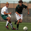 (4) Chase Havemann (R), of Los Alamos, gets past Presley Paxson (L) of Farmington in a boys soccer game on Nov. 7, 2009 for the state championship title in Albuquerque, N.M.. The Hilltoppers lost, 0-3.<br />  Natalie GuillŽn/The New Mexican