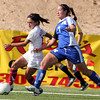 (7) Michelle Bustamante, of St. Michael's, dribbles past (11)Savannah Davidson, of Sandia Prep High School during the New Mexico state girls soccer championships on Nov. 7, 2009. The Lady Horsemen won in double overtime, 3-2.<br />  Natalie GuillŽn/The New Mexican