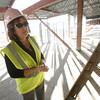 Principal of the new Amy Biehl school in Rancho Viejo, Pam De La O, takes a walk through the construction site of her school on Nov. 4, 2009.          (Luis Sanchez Saturno/The New Mexican)
