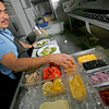 Hector Garcia, from Santa Fe, works on making a pair of salads for a couple of costumers at The Museum Hill Cafe on nov. 17, 2009. The cafe will close at the end of November, says Walter Burke who has run the luncheon restaurant amid the cluster of state museums on Santa Fe's east side since it opened in May of 2002.          Luis Sanchez Saturno/ The New Mexican