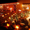 "Roy and Dorothy Gonzales have decorated their house for more than 20 years with over 3,000 lights. ""It usually takes us more than two days to put up the 30 strands of lights and then add the farolitos,"" said Dorothy. <br /> Natalie Guillen/The New Mexican"