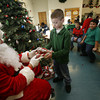 City of Santa Fe Youth Programs at the Monica Roybal celebrated its 25th year having Santa hand out gifts to children.<br /> Photos by Jane Phillips/ The New Mexican