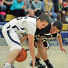 Capital's Paul Toya, number 33, tries to steal the ball from Santa Fe's Michael Dean, number 25, during the first quarter of the Santa Fe High School boys basketball vs Capital High School at Santa Fe High School on Jan. 8, 2010.          Luis Sanchez Saturno/ The New Mexican