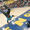 Manny Chavez, 17, from Santa Fe, does a cartwheel while the Santa Fe Spirit Allstar Cheerleaders perform during the half time show during Santa Fe High School boys basketball vs Capital High School at Santa Fe High School on Jan. 8, 2010.          Luis Sanchez Saturno/ The New Mexican