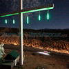 A glow stick lit cross overlooks pilgrims as they make their way to the Santuario de Chimayo on Juan Medina Rd during good Friaday on April 22, 2011.<br /> <br /> Photo by Luis Sanchez Saturno/The New Mexican