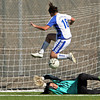 (16) Kate Vadurro, of St. Michael's, gets the ball past Bosque High School goalkeeper, Krystal Melendez, during a girls soccer game on Nov. 6, 2009. The Lady Horsemen won, 3-2, advancing them to the finals on Saturday at 10 a.m.<br />  Natalie GuillŽn/The New Mexican