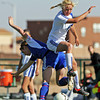 (9) Jamie Palermo, of St. Michael's, gets to the ball before (7) Robin Bauman, of Bosque High School, during a girls soccer game on Nov. 6, 2009. The Lady Horsemen won, 3-2, advancing them to the finals on Saturday at 10 a.m.<br />  Natalie GuillŽn/The New Mexican