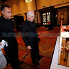 Arch Bishop Michael Sheehan and Father Adam Ortega, select a piece for the Arch Bishop's Award at the Santa Fe Community Convention Center on Friday, July 27, 2012. The Arch Bishop's Award has been given since 1992. Photo by Luis Sanchez Saturno/The New Mexican