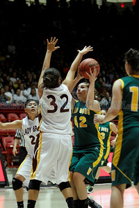 The first quarter of the Santa Fe Indian School vs West Las Vegas High School girls basketball game during the State Girls Basketball Tournament at The Pit on Mar. 8, 2011.  Photo by Luis Sánchez Saturno/The New Mexican