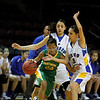 Pecos' Yeshemabet Turner, number 23,is double teamed by Peñasco's Abigail Soot, number 30, and Kimberly Vigil, number 13, during the first quarter of the Pecos High School vs Peñasco High School girls basketball game during the State Girls Basketball Tournament at the Santa Ana Star Center on Mar. 8, 2011.<br /> <br /> Photo by Luis Sánchez Saturno/The New Mexican