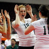 Los Alamos' Erin Kirk, number 12, celebrates with her team during the fourth game of the Los Alamos vs Roswell 2012 State Volleyball Championship quarter final match at Santa Ana Star Center on Thursday, November 16, 2012. Photo by Luis Sánchez Saturno/The New Mexican