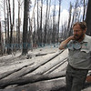 David Old, from Pecos, walks through Viveash Ranch on June 7, 2013, surveying the fire damage to his property. Photo by Luis Sanchez Saturno/The New Mexican