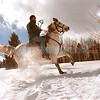 phot serv/photo/outdoors/<br /> Julie Graber photo<br /> Brian Schultz of Santa Fe takes a ride through the snow Sunday afternoon near Hopewell Lake on Sparky, an Andalusian horse of the Vallecitos Stables.
