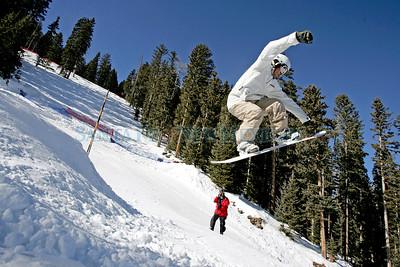 A snowboarder comes in for a landing from a 25 foot jump at the Crazy Mother terrain park during it's grand opening at the Pajarito Mountain Ski Area on Jan. 17, 2009.          (Luis Sanchez Saturno/The New Mexican)